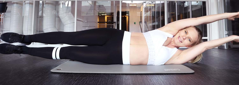liggande balansövning magmuskeldelning träning