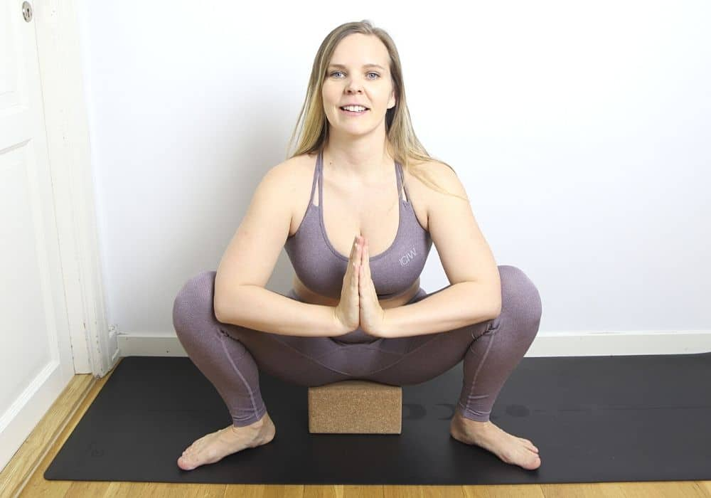 Malasana yoga övning block